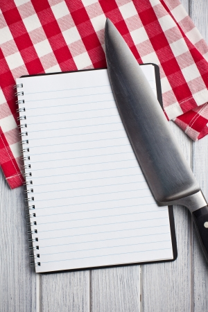 the blank recipe book with kitchen knife photo