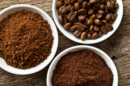 instant coffee: coffee beans, ground coffee and instant coffee in three bowls