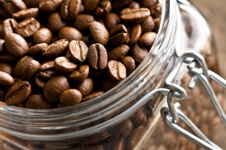 detail of coffee beans in glass jar photo