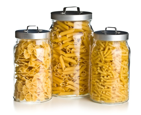 the various raw pasta in a glass jar photo