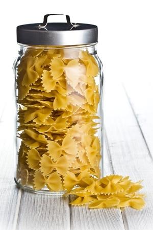 pasta farfalle in glaas jar photo
