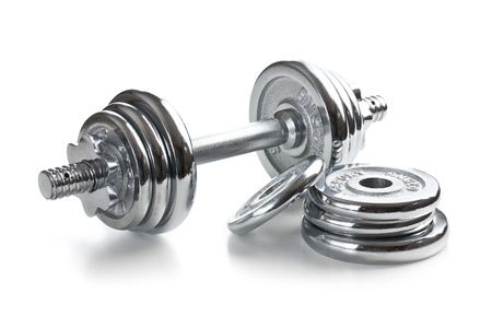 Chromed fitness dumbbell on white background photo