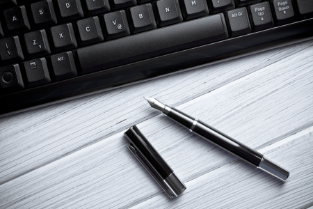 the fountain pen and computer keyboard Stock Photo - 14941530