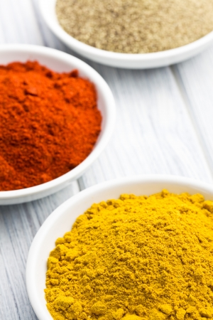 various colored spices in ceramic bowls Stock Photo - 14941444