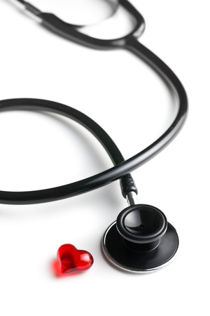stethoscope and red heart on white background photo