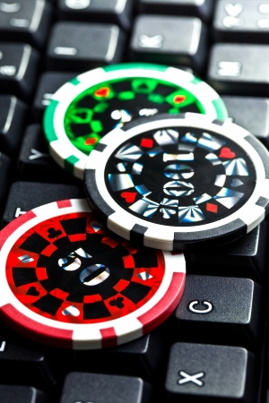 the poker chips on computer keyboard photo