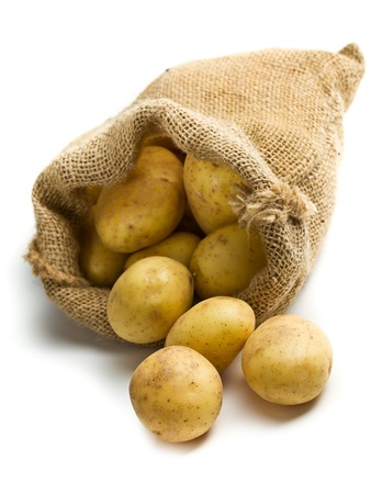 potatoes in burlap sack on white background photo