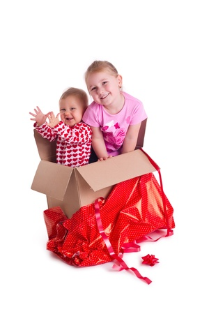 studio shot of two child in gift box photo