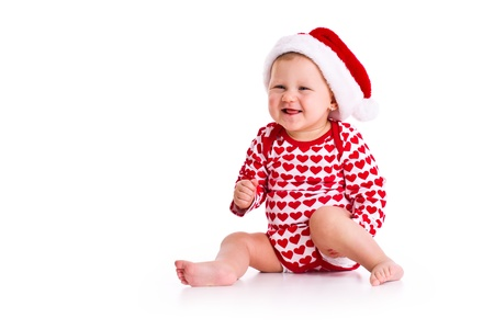 studio shot of baby in Santas hat photo