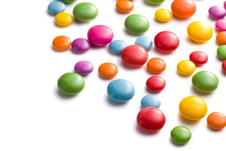chocolate background: colored candy on white background
