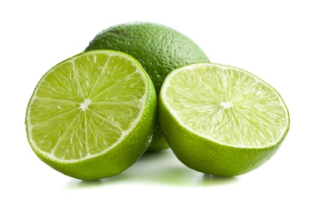 two halves of lime on white background
