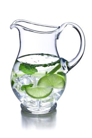pitcher of lemonade on white background