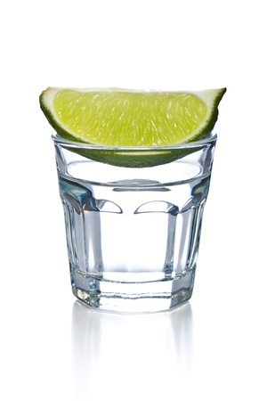 back shots: glass of clear alcohol on white background