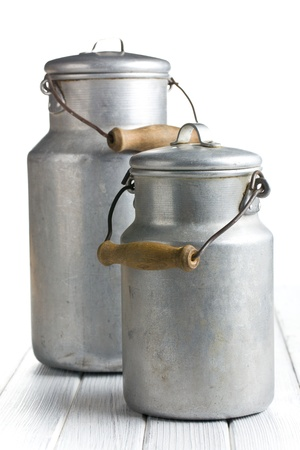 milk jugs: aluminium milk can on wooden table