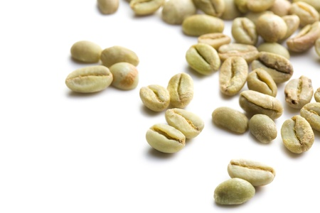 arabic coffee: green coffee beans on white background