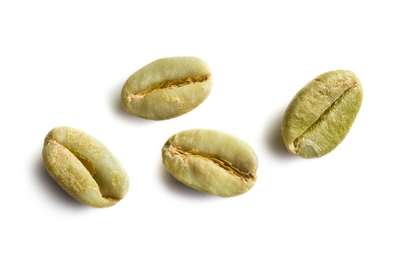 unroasted: green coffee beans on white background