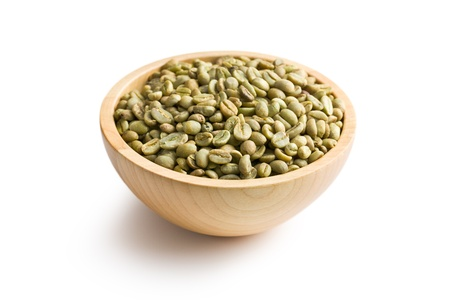 green bean: green coffee in wooden bowl on white background