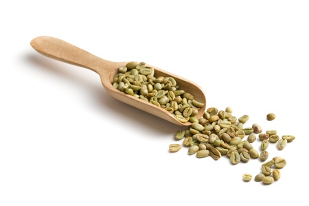 coffee crop: green coffee in wooden scoop on white background Stock Photo
