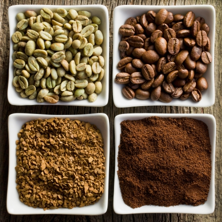 green bean: green, roasted, ground and instant coffee in ceramic bowls