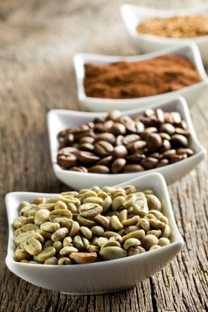 instant coffee: green, roasted, ground and instant coffee in ceramic bowls