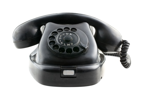 antique black phone on white background photo