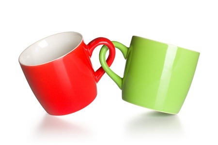 two coupled coffee mugs on white background photo