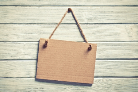 the paper board hanging on wooden wall Stock Photo - 15758968