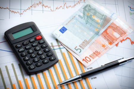 Calculator and euro currency on business graph. Business concept. photo