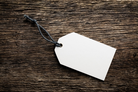 brand tag: the blank price tag label on wooden background