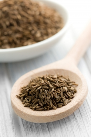 cumin: the cumin seeds in wooden spoon Stock Photo
