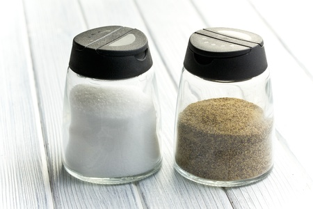 salt pepper: salt and pepper shaker on white table Stock Photo