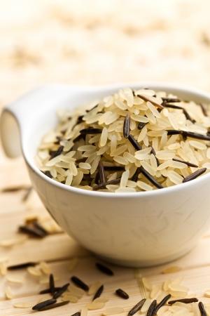 wild rice: wild rice in ceramic bowl on table Stock Photo