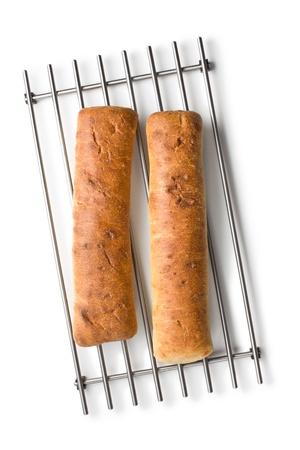 baked ciabatta bread on white background photo