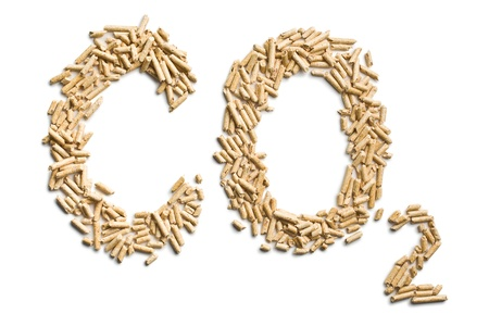 word co2 made of wood pellets on white background photo