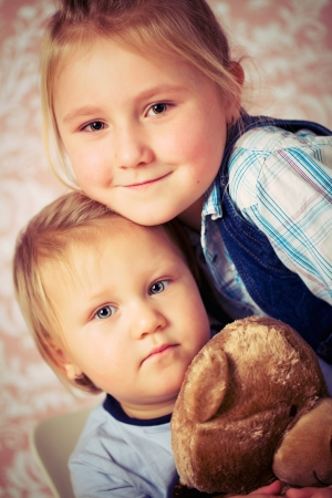 studio portrait of two sisters photo
