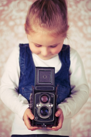 young girl in studio with analogue camera Stock Photo - 16301477
