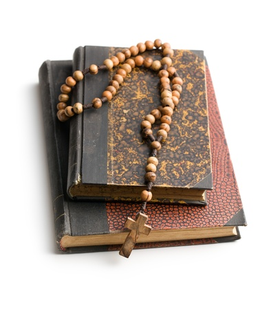 holy bible and rosary beads on white background photo