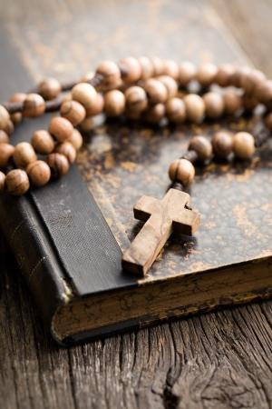catholic symbols: the holy bible and rosary beads