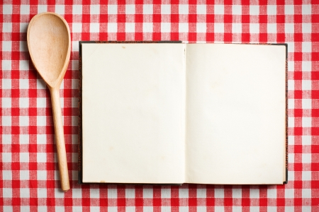 cook book: open old recipe book on checkered tablecloth