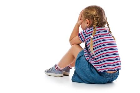 Crying little girl. Studio shot on white background.