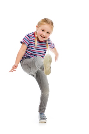 girl kick: Little girl kick by foot. Studio shot. Stock Photo