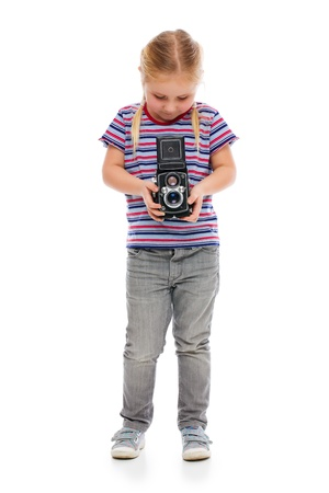 Little girl with old camera. Studio shot. photo