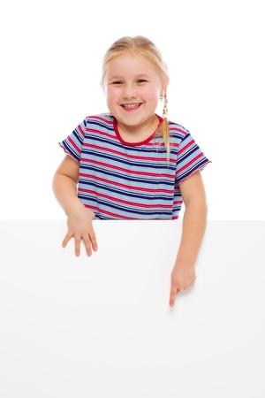 little finger: Little girl pointing at whiteboard. Studio shot.