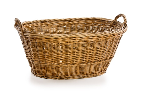 empty wicker basket on white background photo