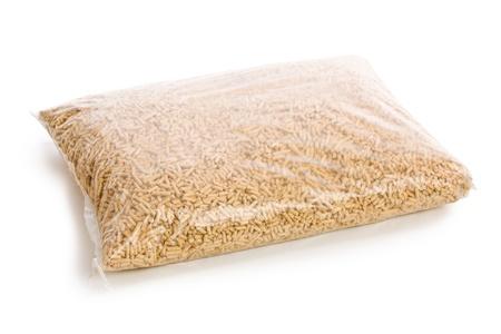 pellets: wooden pellets in plastic bag on white background