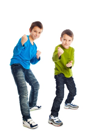 stance: Two boys in a fighting stance. Studio shot.