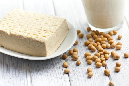 tofu and soy beans on kitchen table Stock Photo