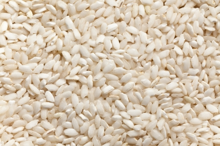 the uncooked arborio rice background Stock Photo