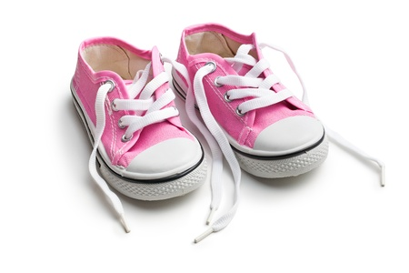 baby shoes: pink baby sneakers on white background