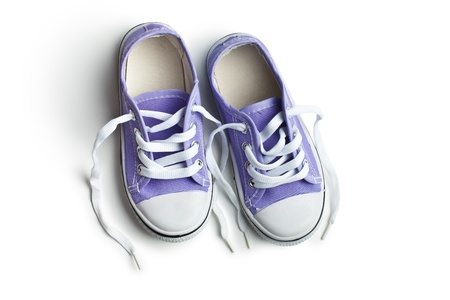 purple baby sneakers on white background photo